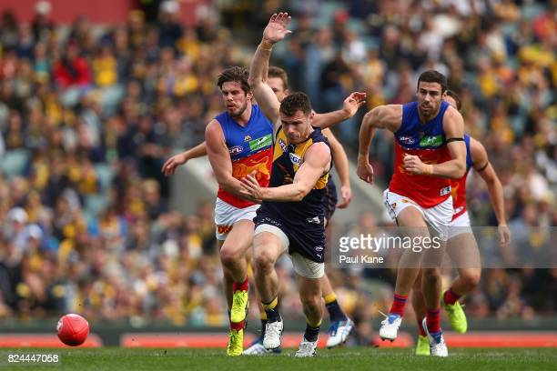 Luke Shuey of the Eagles contests for the ball during the round 19 AFL match between the West Coast Eagles and the Brisbane Lions at Domain Stadium...