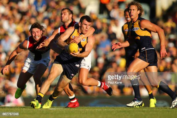 Luke Shuey of the Eagles gets tackled by Maverick Weller of the Saints during the round two AFL match between the West Coast Eagles and the St Kilda...