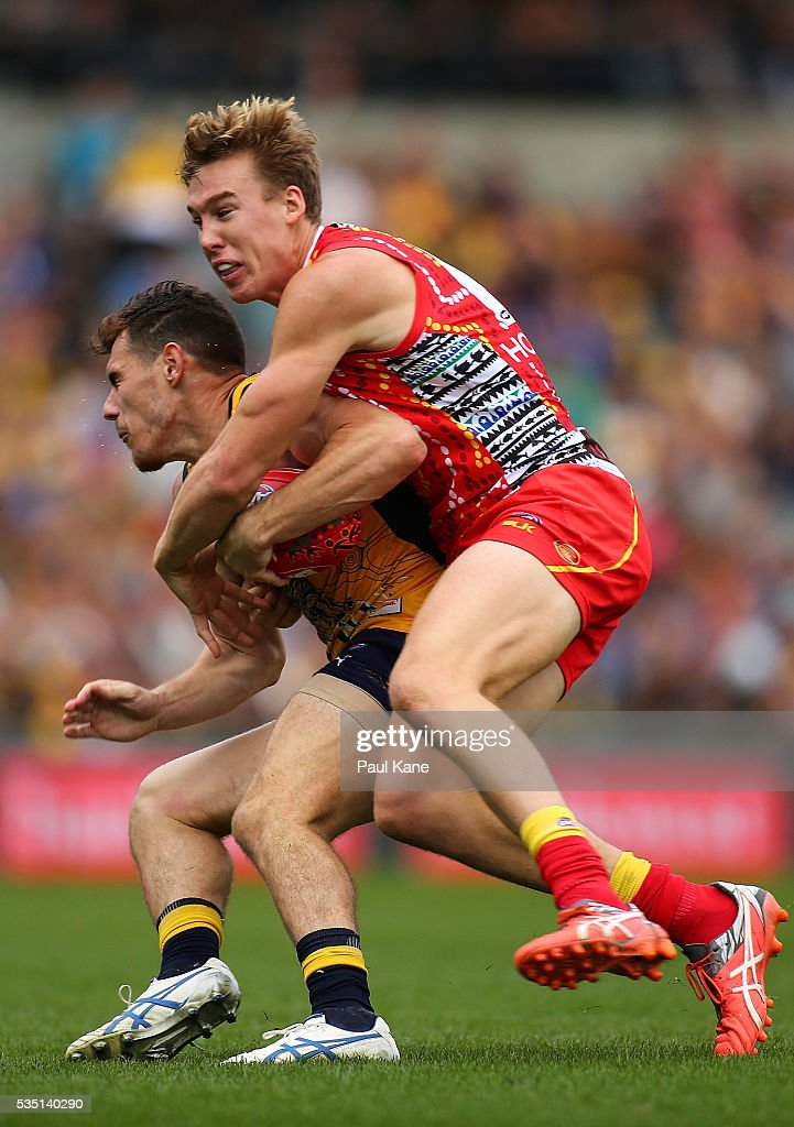 Luke Shuey of the Eagles gets tackled by Tom Lynch of the Suns during the round 10 AFL match between the West Coast Eagles and the Gold Coast Suns at Domain Stadium on May 29, 2016 in Perth, Australia.