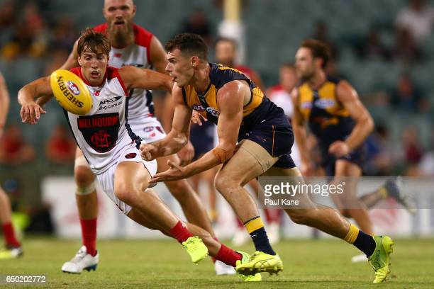 Luke Shuey of the Eagles handballs during the JLT Community Series AFL match between the West Coast Eagles and the Melbourne Demons at Domain Stadium...