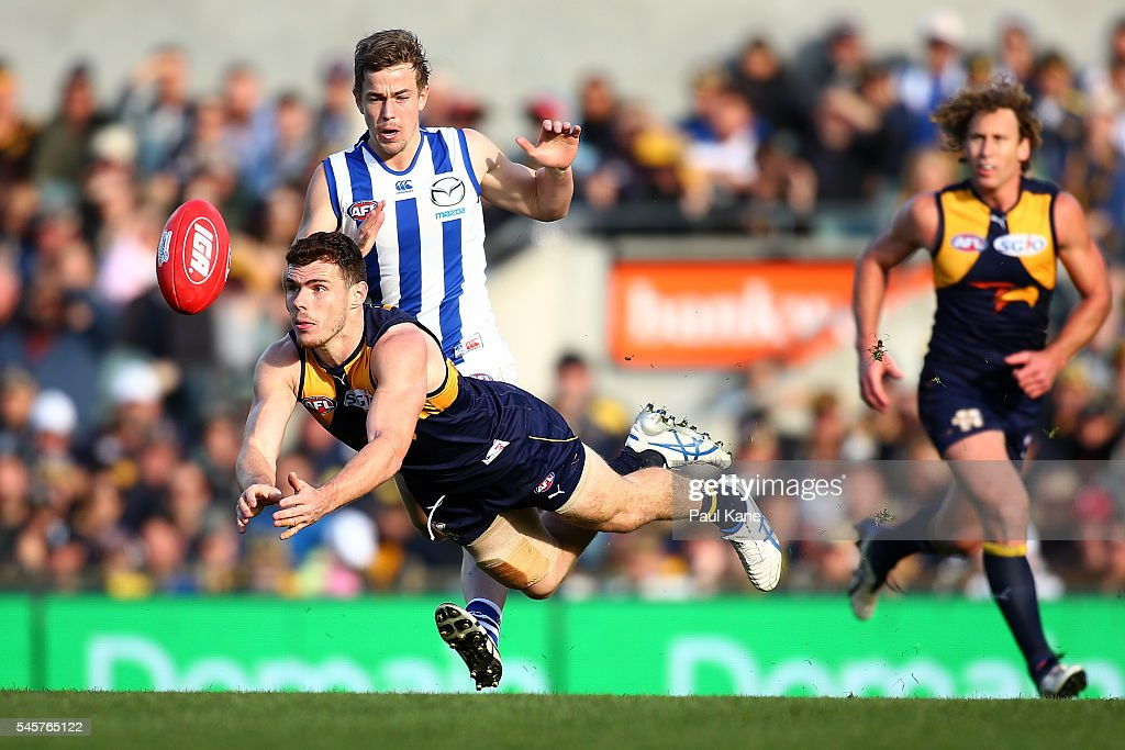 Luke Shuey of the Eagles handballs during the round 16 AFL match between the West Coast Eagles and the North Melbourne Kangaroos at Domain Stadium on July 10, 2016 in Perth, Australia.
