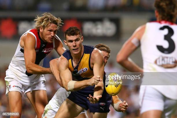 Luke Shuey of the Eagles handballs during the round two AFL match between the West Coast Eagles and the St Kilda Saints at Domain Stadium on April 1...