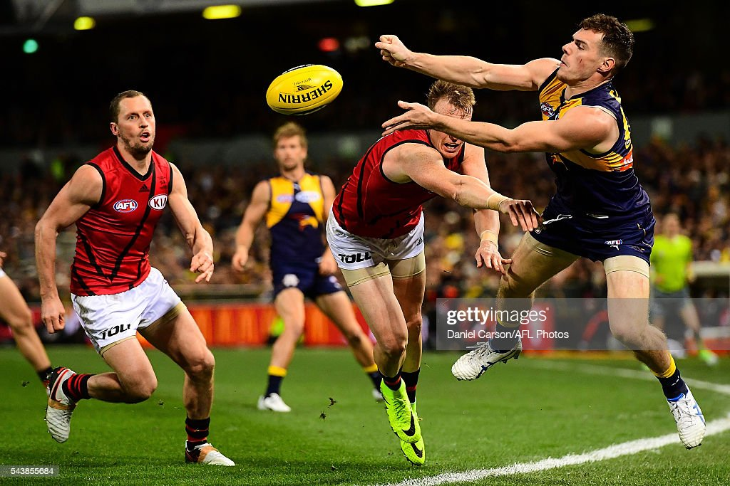 Luke Shuey of the Eagles handballs the ball to keep it in play during the 2016 AFL Round 14 match between the West Coast Eagles and the Essendon Bombers at Domain Stadium on June 30, 2016 in Perth, Australia.
