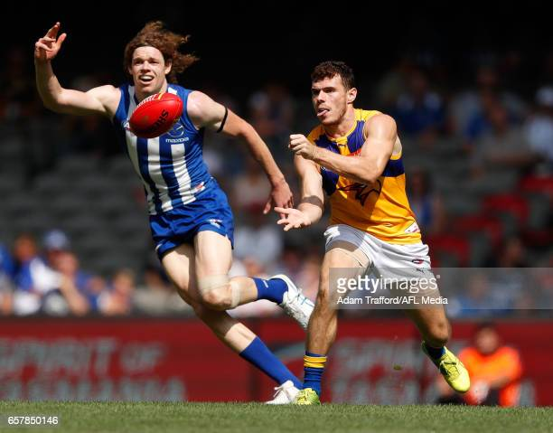 Luke Shuey of the Eagles handpasses the ball ahead of Ben Brown of the Kangaroos during the 2017 AFL round 01 match between the North Melbourne...