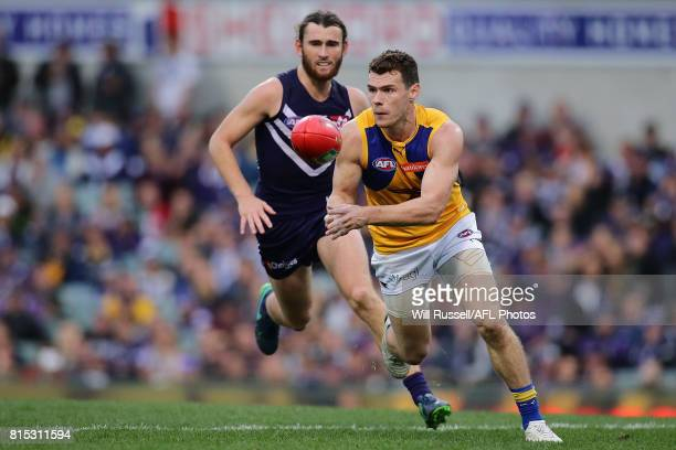 Luke Shuey of the Eagles handpasses the ball during the round 17 AFL match between the Fremantle Dockers and the West Coast Eagles at Domain Stadium...