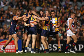 Luke Shuey of the Eagles is congratulated by team mates after kicking a goal during the round 15 AFL match between the West Coast Eagles and the...