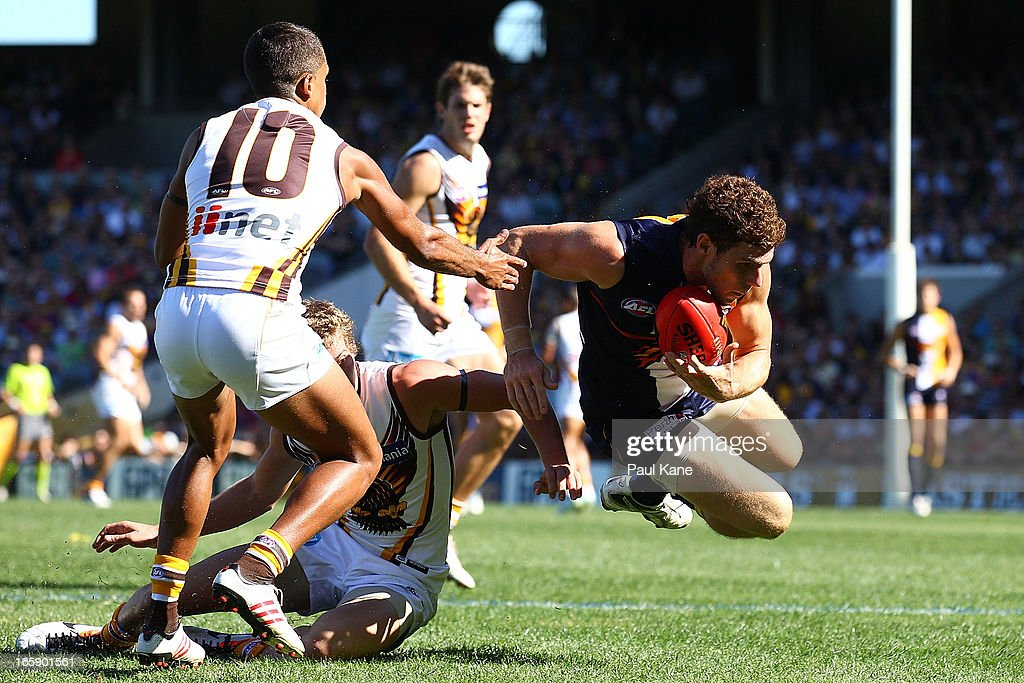Luke Shuey of the Eagles jumps to evade a tackle during the round two AFL match between the West Coast Eagles and the Hawthorn Hawks at Patersons Stadium on April 7, 2013 in Perth, Australia.