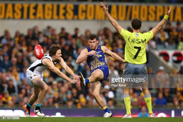 Luke Shuey of the Eagles kicks the ball into the forward line during the round 16 AFL match between the West Coast Eagles and the Port Adelaide Power...