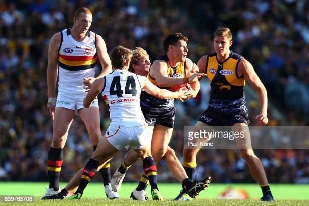 Luke Shuey of the Eagles looks to break from a tackle during the round 23 AFL match between the West Coast Eagles and the Adelaide Crows at Domain...