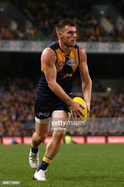 Luke Shuey of the Eagles looks to pass the ball during the round 13 AFL match between the West Coast Eagles and the Geelong Cats at Domain Stadium on...