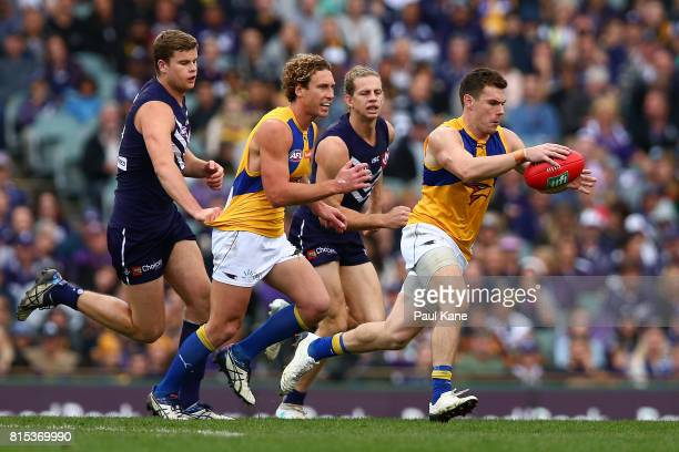 Luke Shuey of the Eagles looks to pass the ball during the round 17 AFL match between the Fremantle Dockers and the West Coast Eagles at Domain...