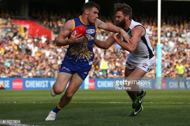 Luke Shuey of the Eagles marks the ball inside the line against Justin Westhoff of the Power during the round 16 AFL match between the West Coast...