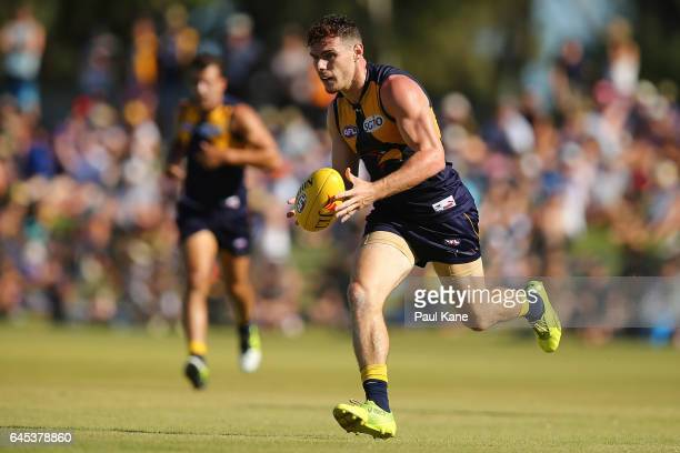 Luke Shuey of the Eagles runs with the ball during the JLT Community Series AFL match between the West Coast Eagles and the Fremantle Dockers at...