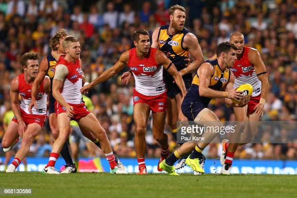 Luke Shuey of the Eagles runs with the ball during the round four AFL match between the West Coast Eagles and the Sydney Swans at Domain Stadium on...