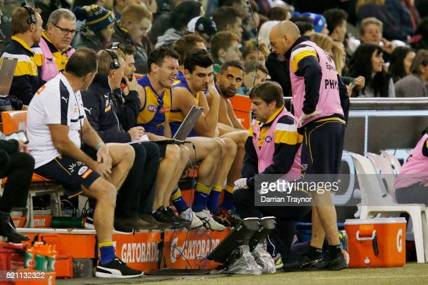 Luke Shuey of the Eagles winces in pain on the interchange bench during the round 18 AFL match between the Collingwood Magpies and the West Coast...