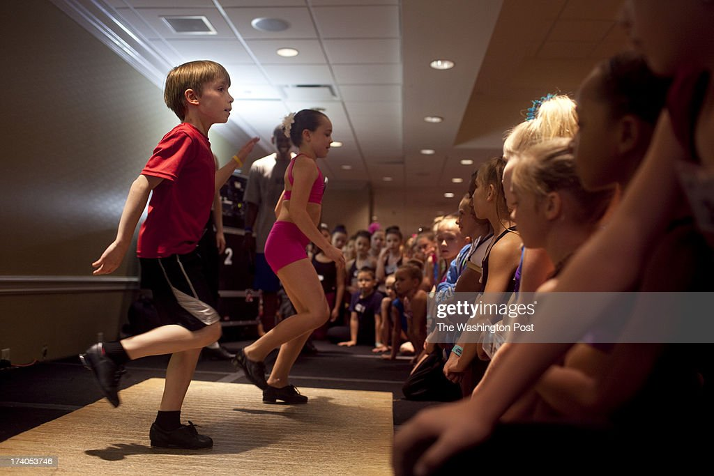Luke Spring, 10, left, dances on stage with Amy Eckman, 10, center, during the Mini Jazz Class at the New York City Dance Alliance National Summer Workshop held at the Sheraton New York Times Square Hotel in New York, NY on July 05, 2013. Luke Spring, a dance prodigy from Studio Bleu Dance Center in Ashburn, VA, has performed on the Tonys, Ellen, So You Think You Can Dance and The Ford Gala. His sisters Cami Spring, 20, and Lucy Spring, 18, are both award winning dancers.