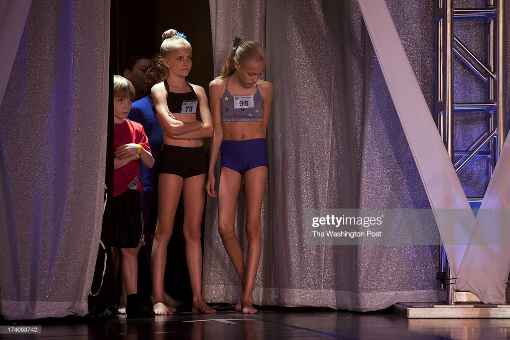 Luke Spring, 10, stands beside Rylie Parker, 10, and Grace Skowron, 9, right, during rehearsals for the Junior Gala at the New York City Dance Alliance National Summer Workshop held at the Sheraton New York Times Square Hotel in New York, NY on July 05, 2013. Luke Spring, a dance prodigy from Studio Bleu Dance Center in Ashburn, VA, has performed on the Tonys, Ellen, So You Think You Can Dance and The Ford Gala. His sisters Cami Spring, 20, and Lucy Spring, 18, are both award winning dancers.