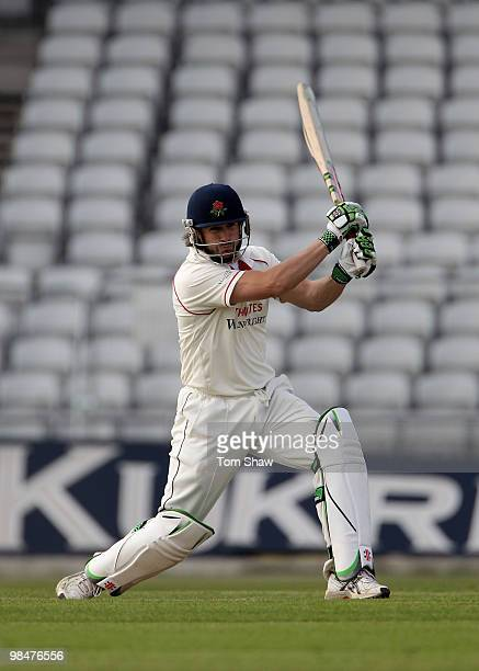Luke Sutton of Lancashire hits out during the LV County Championship match between Lancashire and Warwickshire at Old Trafford on April 15 2010 in...