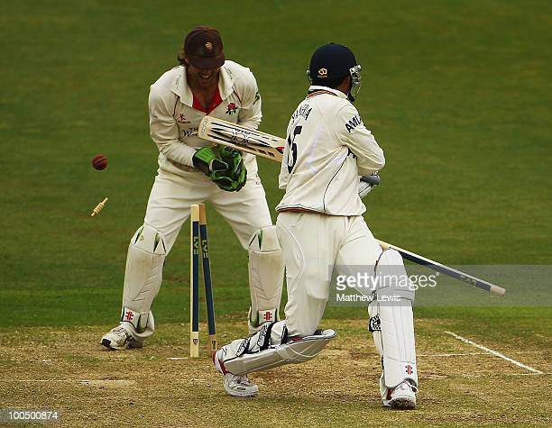 Luke Sutton of Lancashire looks on as Danish Kaneria of Essex is bowled by Simon Kerrigan of Lancashire during the LV County Championship match...