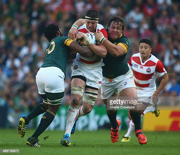 Luke Thompson of Japan drives through the South Africa defence during the 2015 Rugby World Cup Pool B match between South Africa and Japan at the...