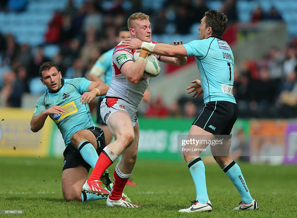 Luke Thompson of St Helens is tackled by <a gi-track='captionPersonalityLinkClicked' href=/galleries/search?phrase=Luke+Dorn&family=editorial&specificpeople=2443137 ng-click='$event.stopPropagation()'>Luke Dorn</a> of London Broncos during the Super League match between London Broncos and St Helens at Twickenham Stoop on April 27, 2013 in London, England.