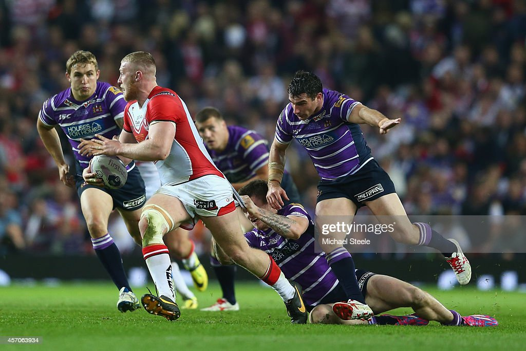 Luke Thompson of St Helens makes a break during the First Utility Super League Grand Final match between St Helens and Wigan Warriors at Old Trafford...