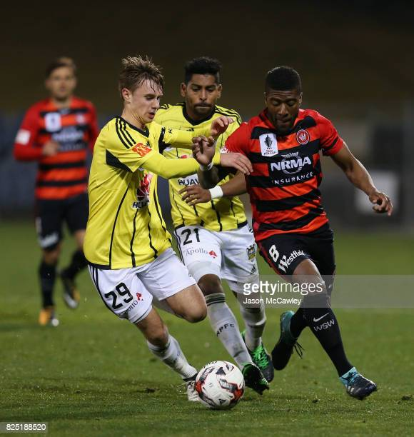 Luke Tongue of the Phoenix and Roly Bonevacia of the Wanderers compete for the ball during the FFA Cup round of 32 match between the Western Sydney...
