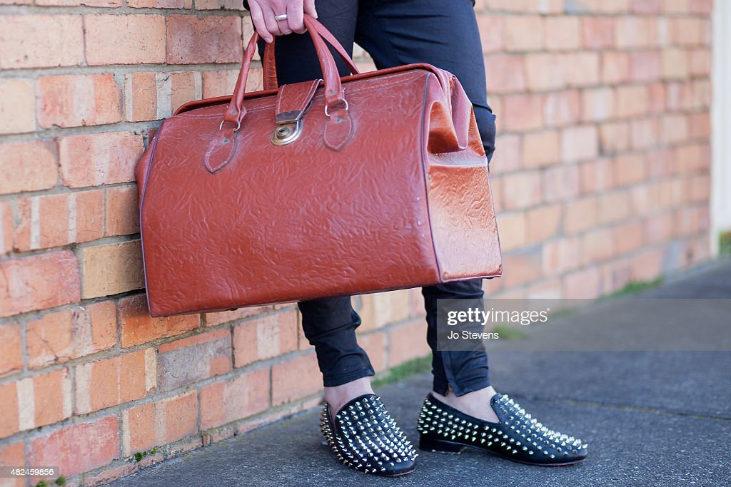 Luke Tonkin photographer / stylist wears Lee Jeans, Louis Burton shoes with a vintage doctors bag and ring from a Sydney market, on July 28, 2015 in Melbourne, Australia.