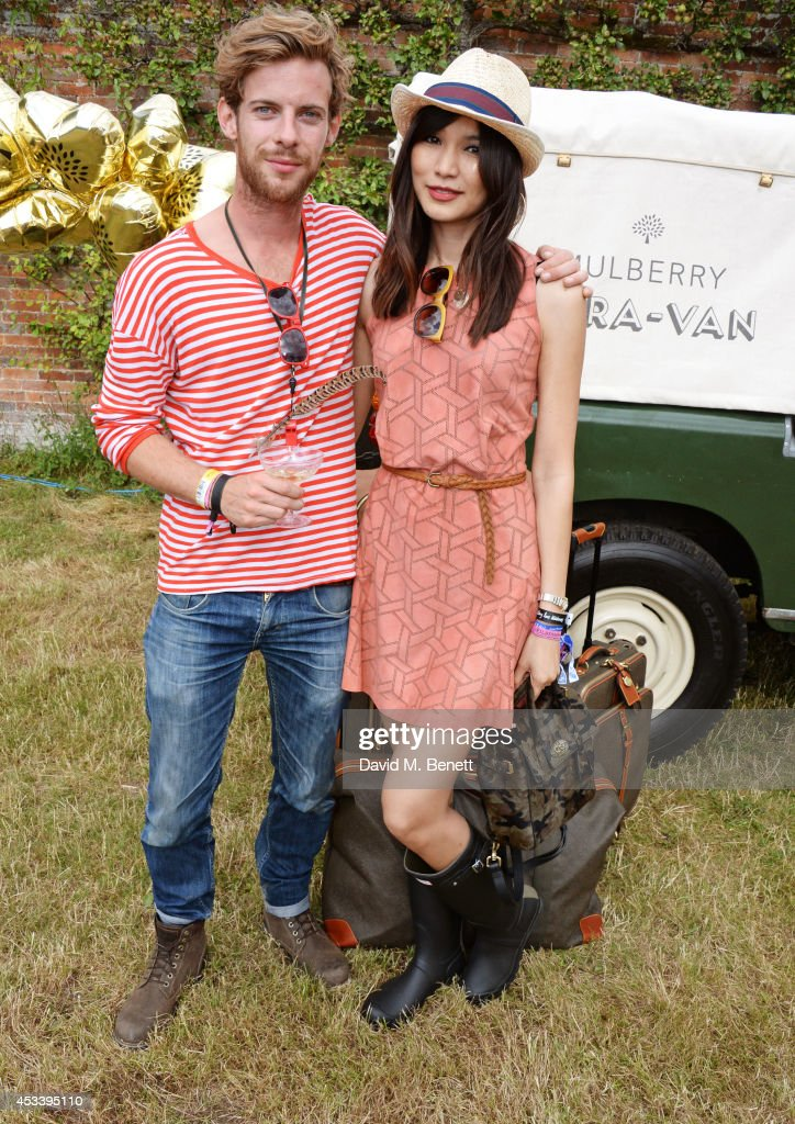Luke Treadaway and Gemma Chan attend The Mulberry Wilderness Picnic with Cara Delevingne during Wilderness 2014 at Cornbury Park on August 9 2014 in...