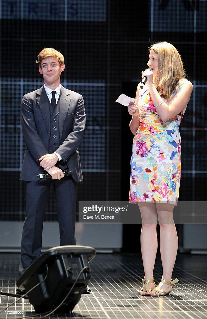 <a gi-track='captionPersonalityLinkClicked' href=/galleries/search?phrase=Luke+Treadaway&family=editorial&specificpeople=737104 ng-click='$event.stopPropagation()'>Luke Treadaway</a> (L) and Katy Rudd speak on stage at 'A Curious Night at the Theatre', a charity gala evening to raise funds for Ambitious about Autism and The National Autistic Society, at The Apollo Theatre on July 1, 2013 in London, England.