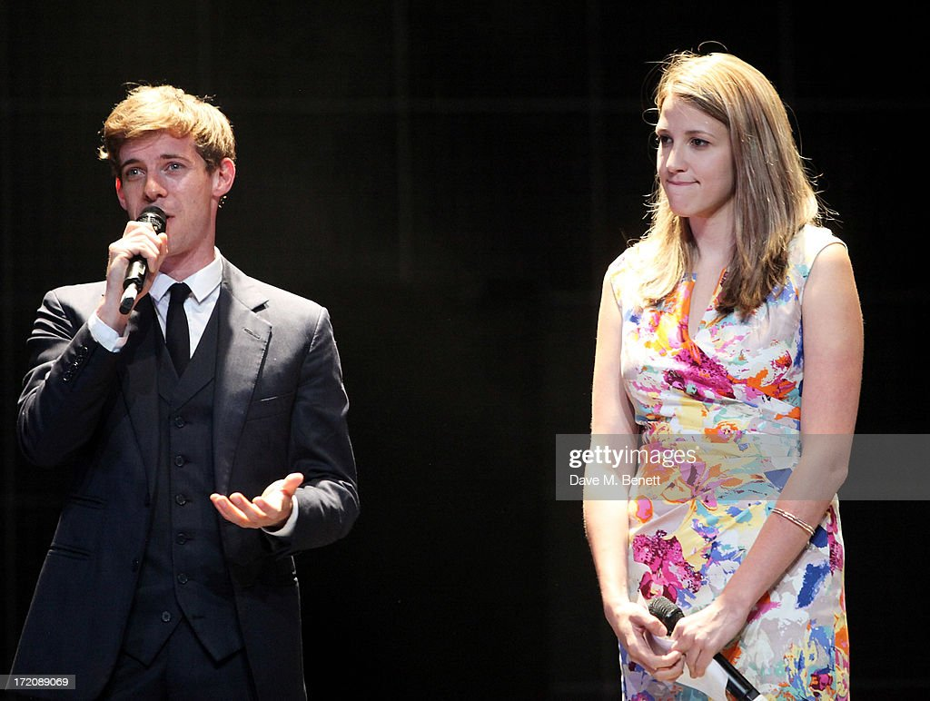 Luke Treadaway (L) and Katy Rudd speak on stage at 'A Curious Night at the Theatre', a charity gala evening to raise funds for Ambitious about Autism and The National Autistic Society, at The Apollo Theatre on July 1, 2013 in London, England.