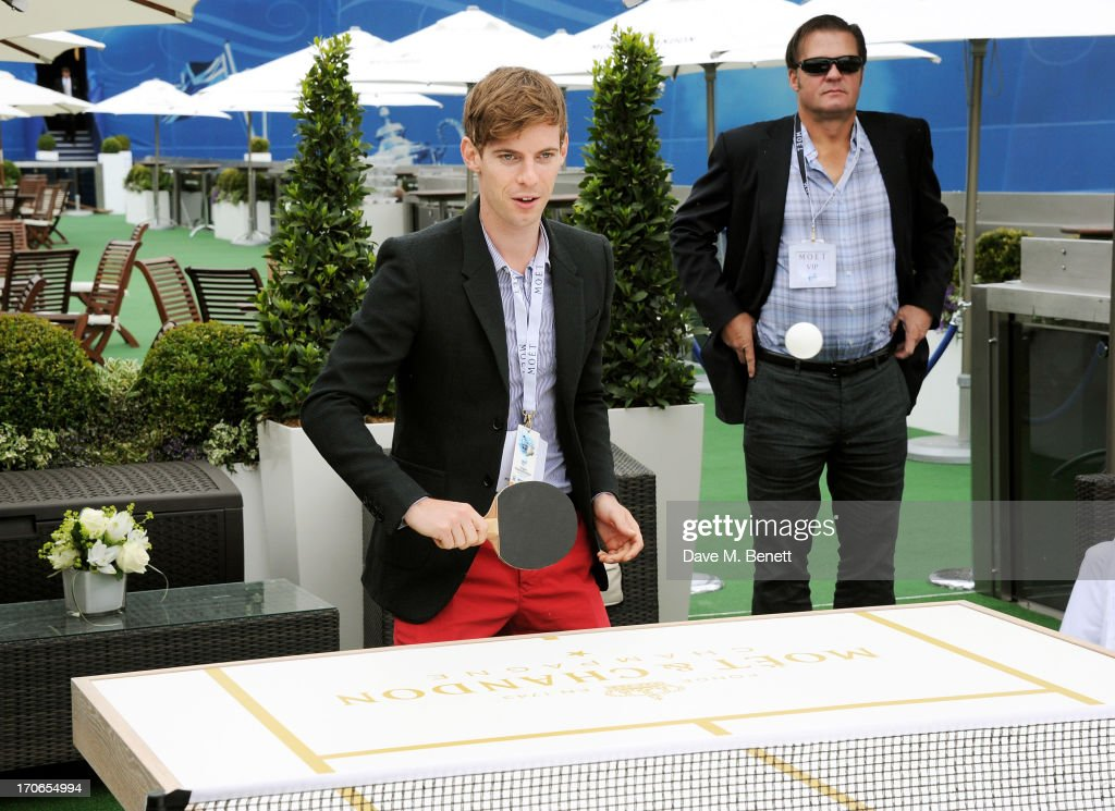 Luke Treadaway plays table tennis at The Moet Chandon Suite at The Aegon Championships Queens Club finals on June 16 2013 in London England