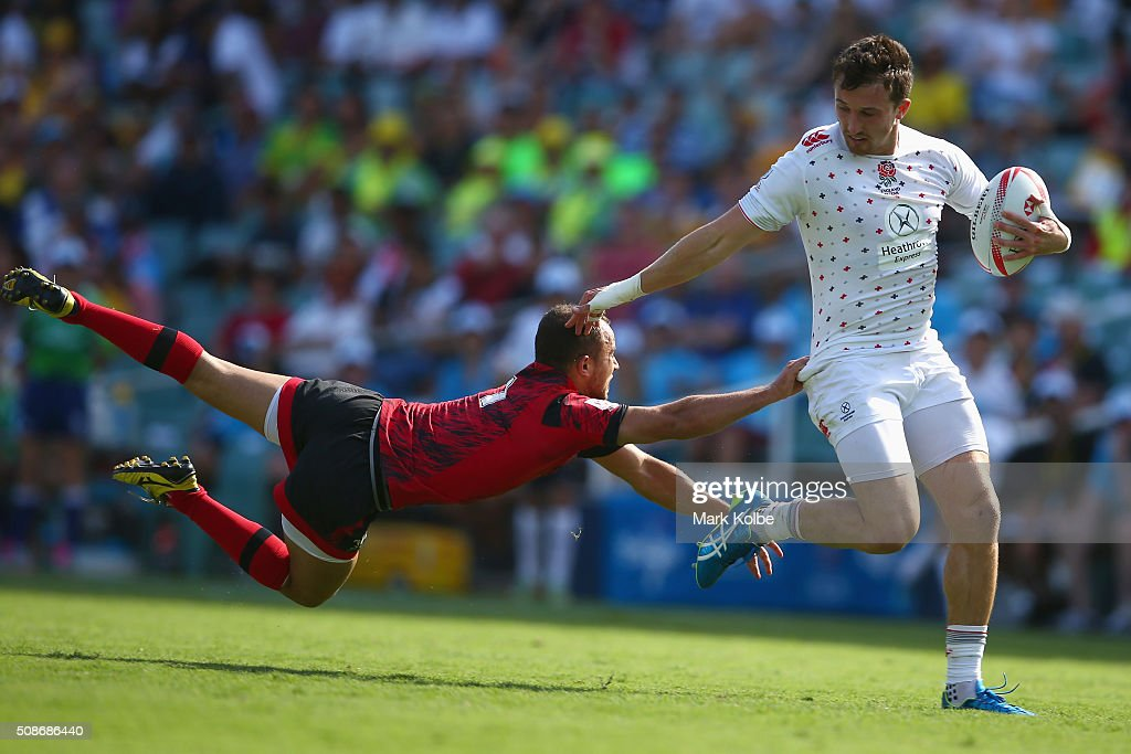 Luke Treharne of Wales dives as he attempts to tackle Alex Davis of England during the match between England and Wales at the 2016 Sydney Sevens at Allianz Stadium on February 6, 2016 in Sydney, Australia.