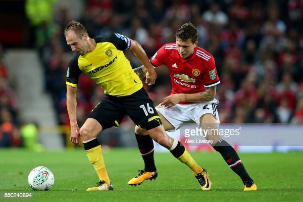 Luke Varney of Burton Albion and Victor Lindelof of Manchester United in action during the Carabao Cup Third Round match between Manchester United...