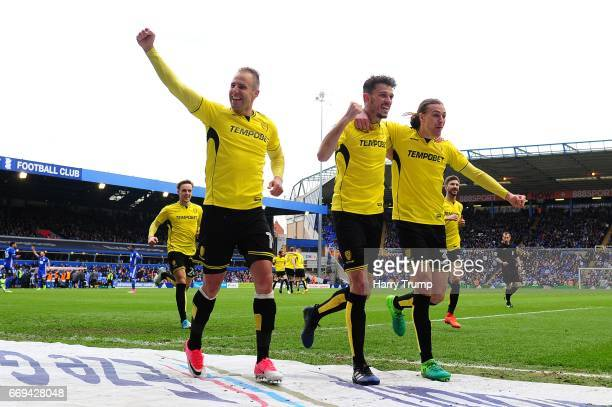 Luke Varney of Burton Albion Tom Flanagan of Burton Albion and Jackson Irvine of Burton Albion celebrates their sides second goal scored by Lucas...