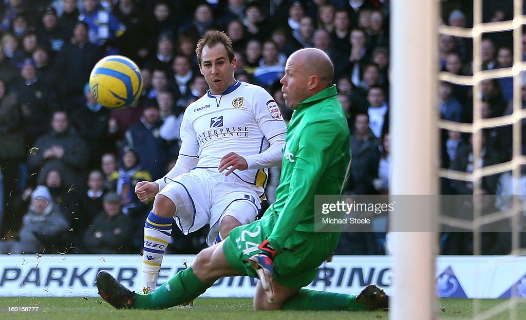 Luke Varney of Leeds scores the opening goal past <a gi-track='captionPersonalityLinkClicked' href=/galleries/search?phrase=Brad+Friedel&family=editorial&specificpeople=210857 ng-click='$event.stopPropagation()'>Brad Friedel</a> of Spurs during the FA Cup with Budweiser Fourth Round match between Leeds United and Tottenham Hotspur at Elland Road on January 27, 2013 in Leeds, England.