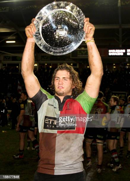Luke Wallace of Harlequins celebrates with the trophy after winning the Aviva 'A' league match between Harlequins and Saracens Storm at the...