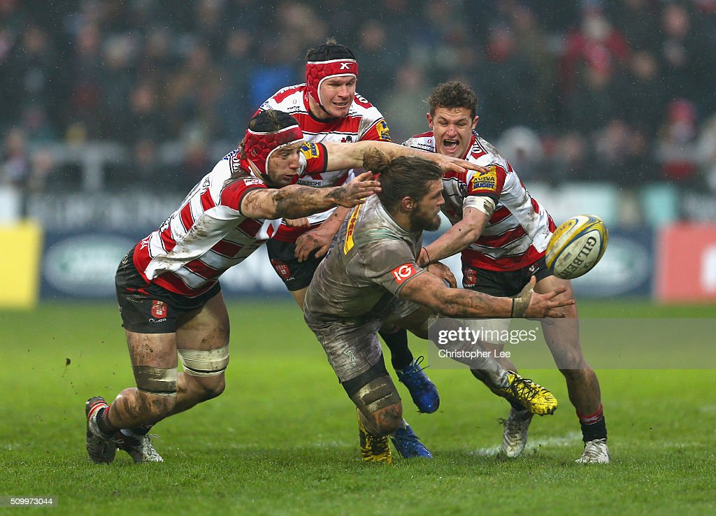 <a gi-track='captionPersonalityLinkClicked' href=/galleries/search?phrase=Luke+Wallace&family=editorial&specificpeople=7156608 ng-click='$event.stopPropagation()'>Luke Wallace</a> of Quins passes the ball as the Gloucester defence gang up to bring him down during the Aviva Premiership match between Gloucester Rugby and Harlequins at Kingsholm Stadium on February 13, 2016 in Gloucester, England.