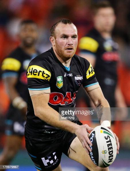 Luke Walsh of the Panthers runs with the ball during the round 22 NRL match between the Penrith Panthers and the North Queensland Cowboys at...