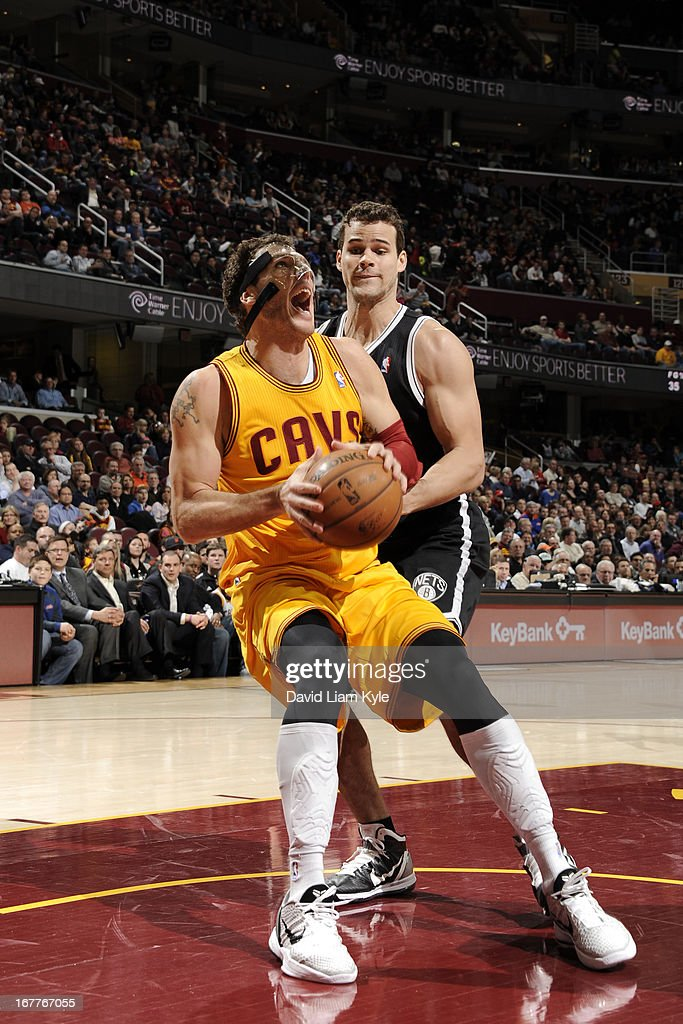 <a gi-track='captionPersonalityLinkClicked' href=/galleries/search?phrase=Luke+Walton+-+Basketball+Player&family=editorial&specificpeople=202565 ng-click='$event.stopPropagation()'>Luke Walton</a> #4 of the Cleveland Cavaliers goes to the basket against <a gi-track='captionPersonalityLinkClicked' href=/galleries/search?phrase=Kris+Humphries&family=editorial&specificpeople=209199 ng-click='$event.stopPropagation()'>Kris Humphries</a> #43 of the Brooklyn Nets at The Quicken Loans Arena on April 3, 2013 in Cleveland, Ohio.