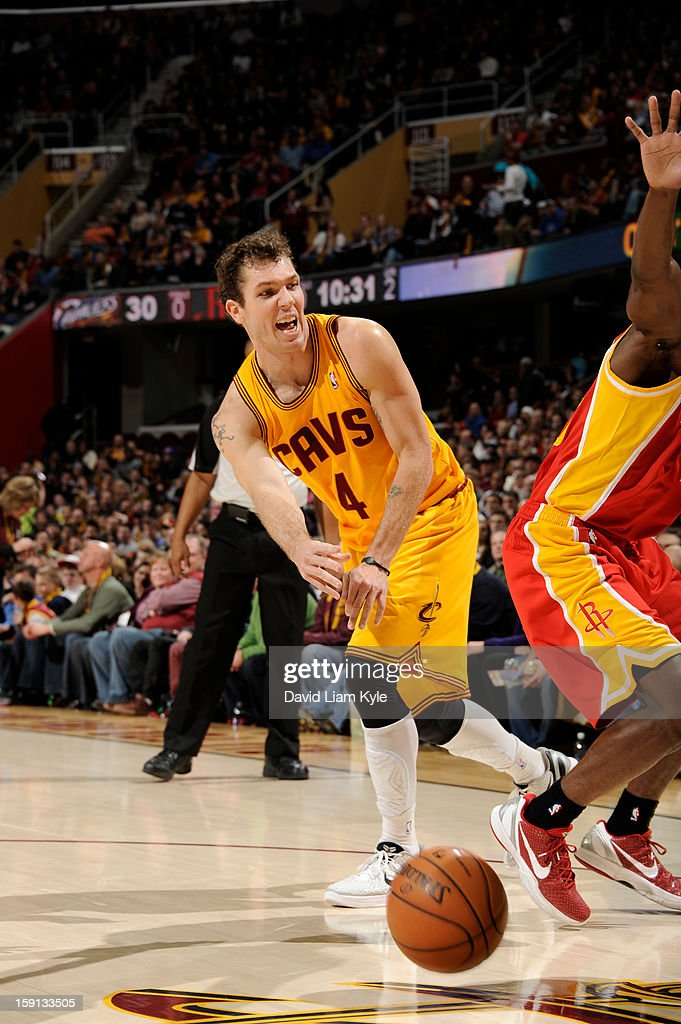 Luke Walton #4 of the Cleveland Cavaliers passes against the Houston Rockets at The Quicken Loans Arena on January 5, 2013 in Cleveland, Ohio.