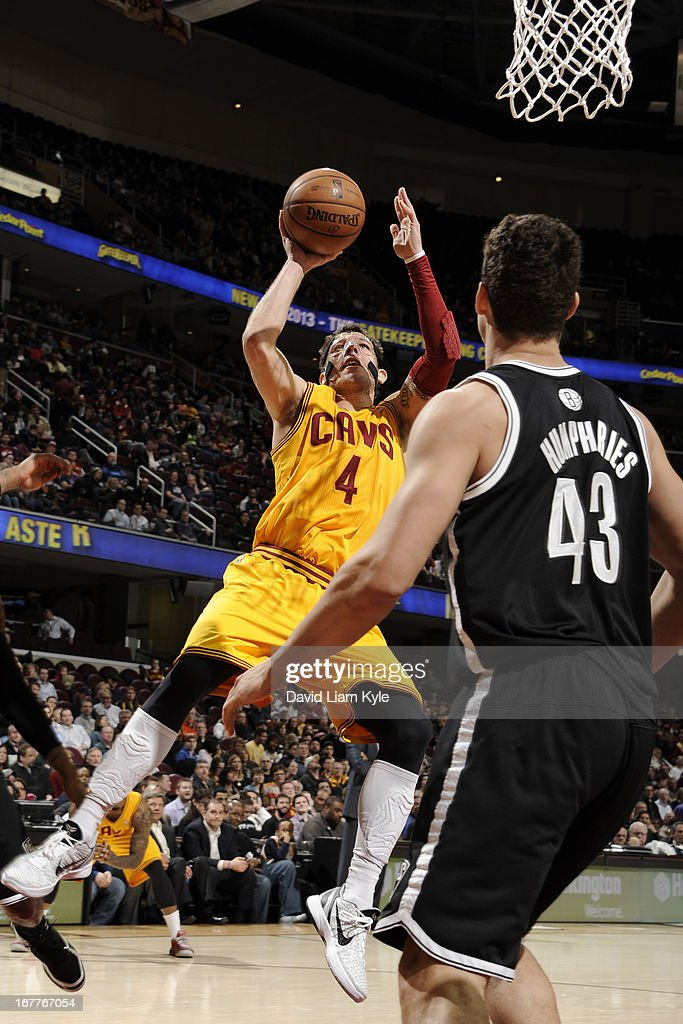 <a gi-track='captionPersonalityLinkClicked' href=/galleries/search?phrase=Luke+Walton&family=editorial&specificpeople=202565 ng-click='$event.stopPropagation()'>Luke Walton</a> #4 of the Cleveland Cavaliers shoots against <a gi-track='captionPersonalityLinkClicked' href=/galleries/search?phrase=Kris+Humphries&family=editorial&specificpeople=209199 ng-click='$event.stopPropagation()'>Kris Humphries</a> #43 of the Brooklyn Nets at The Quicken Loans Arena on April 3, 2013 in Cleveland, Ohio.