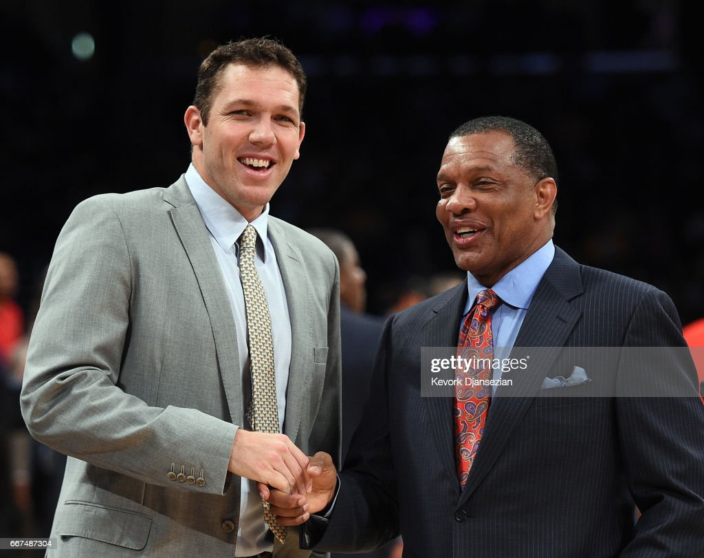 Luke Walton of the Los Angeles Lakers and Alvin Gentry of the New Orleans Pelicans greet each other before the start of a basketball game at Staples Center April 11, 2017, in Los Angeles, California.