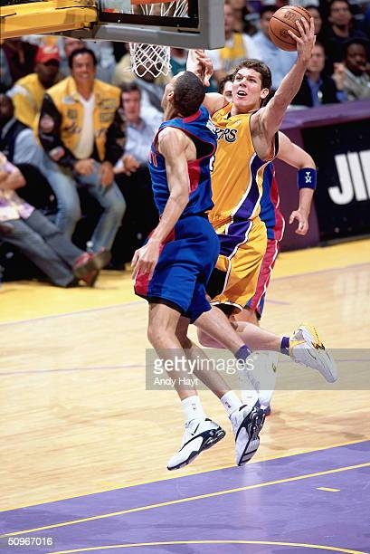 Luke Walton of the Los Angeles Lakers drives to the basket against Tayshaun Prince of the Detroit Pistons during Game one of the 2004 NBA Finals at...