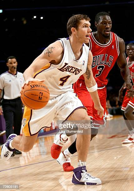 Luke Walton of the Los Angeles Lakers drives to the basket against Ben Wallace of the Chicago Bulls on November 19 2006 at Staples Center in Los...