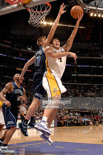 Luke Walton of the Los Angeles Lakers goes to the basket against Andrei Kirilenko of the Utah Jazz at Staples Center on November 4 2007 in Los...
