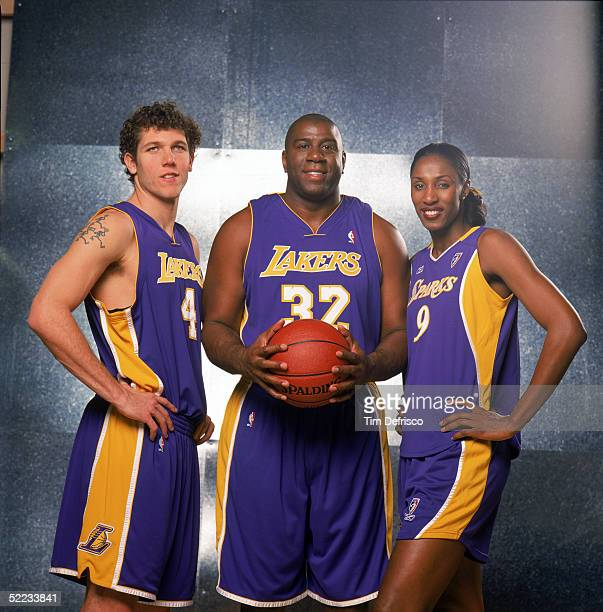 Luke Walton of the Los Angeles Lakers NBA legend Earvin 'Magic' Johnson and Lisa Leslie of the WNBA Los Angeles Sparks pose for a portrait prior to...