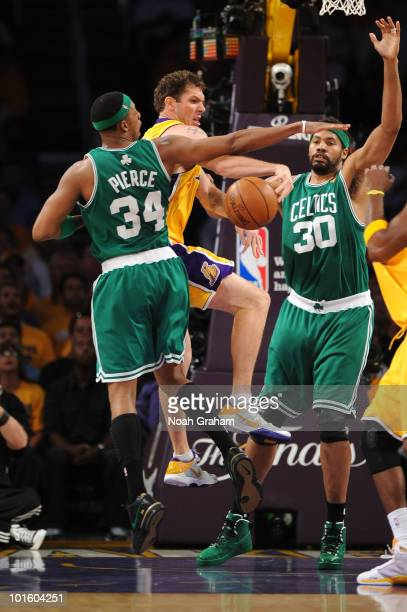 Luke Walton of the Los Angeles Lakers passes against Paul Pierce and Rasheed Wallace of the Boston Celtics in Game One of the 2010 NBA Finals on June...