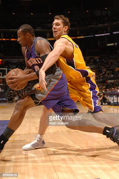 Luke Walton of the Los Angeles Lakers reaches for the ball as Leandro Barbosa of the Phoenix Suns drives past him during their game at Staples Center...