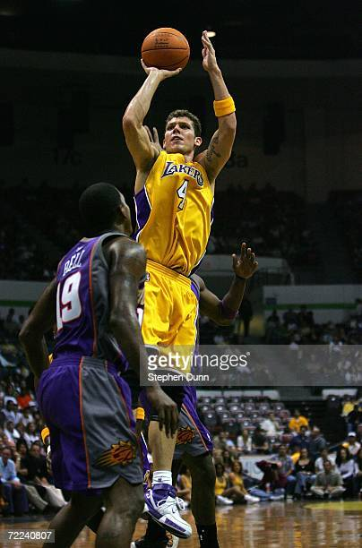 Luke Walton of the Los Angeles Lakers shoots over Raja Bell of the Phoenix Suns during their preseason game on October 22 2006 at the iPayOne Center...